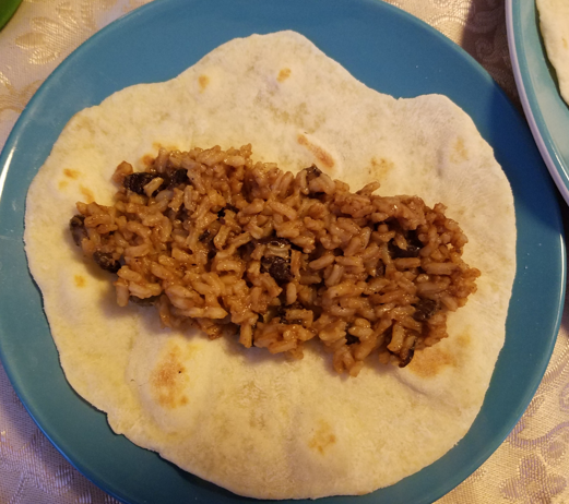 Homemade tortillas with rice and beans