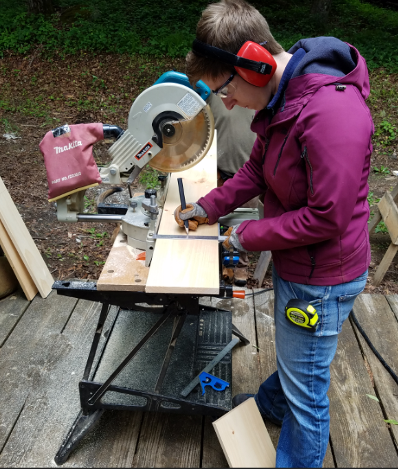 Lauren using the chop saw